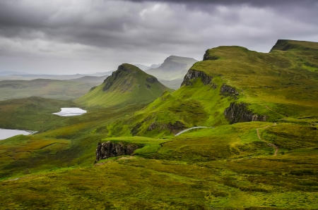 skye: Scenic view of Quiraing mountains with dramatic sky in Scottish highlands, Isle of Skye, United Kingdom