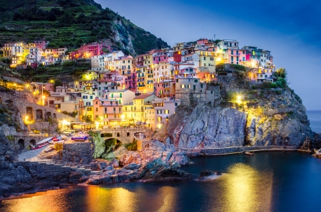 mediterranean houses: Scenic night view of colorful village Manarola in Cinque Terre, Italy