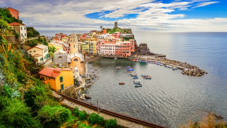 Panoramic view of colorful Vernazza village and ocean coast in Cinque Terre photo