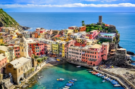 Scenic view of ocean and harbor in colorful village Vernazza, Cinque Terre, Italy photo