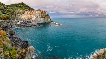 Panoramic view of colorful village Manarola in Cinque Terre, Italy photo