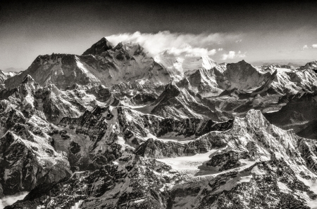 Vintage monochrome view of Mt Everest during mountain flight, Himalayas, Nepal photo