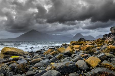 mountainscape: Landscape coastline view of rocks and Cullin hills, Scotland, United Kingdom Stock Photo