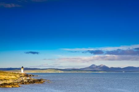 charlotte: Ocean coast lighthouse in Port Charlotte, Scotland, United Kingdom