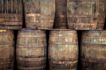bourbon: Stacked pile of old whisky barrels Stock Photo