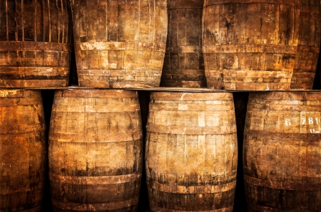 Stacked whisky barrels in monochrome vintage style photo