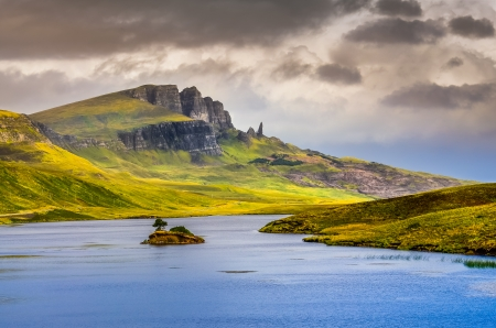 isle: Landscape view of Old Man of Storr rock formation and lake, Scotland, United Kingdom Stock Photo