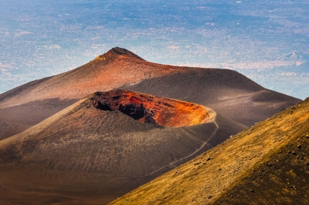 Colorful crater of Etna volcano with Catania in background, Sicily, Italy