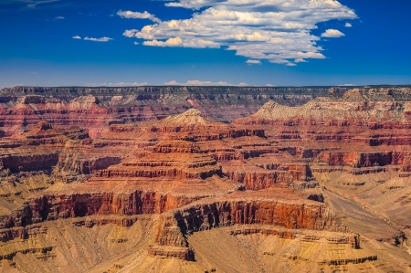 rock layers: Grand Canyon national park scenic view with blue sky and white clouds
