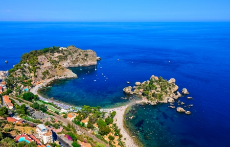 Aerial view of Isola Bella beach coast in Taormina, Sicily, Italy