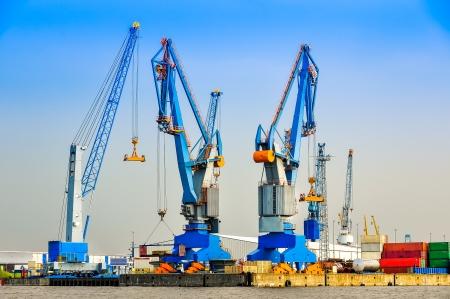 export import: Large industrial cargo cranes in the sea harbor