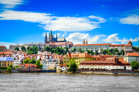 prague: View of colorful old town and Prague castle with river Vltava, Czech Republic