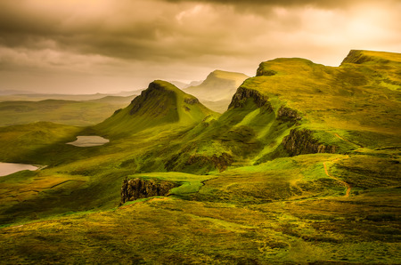 Scenic view of Quiraing mountains sunset with dramatic sky in Scottish highlands, Isle of Skye, United Kingdom Stock Photo