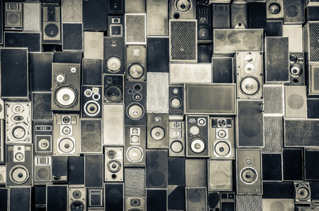 heavy: Music speakers hanging on the wall in monochrome vintage style
