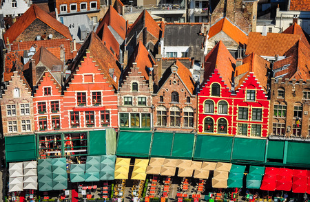 belgium flag: Aerial view of colorful square and houses in Bruges, Belgium