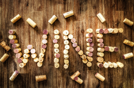 Sign wine made from corks on old wooden vintage table photo