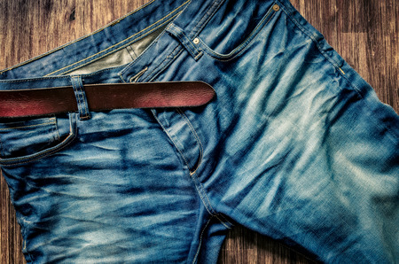 denim: Detail of nice blue jeans with leather belt in vintage style