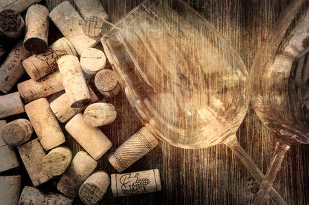Detail of wine glasses and corks in filtered old vintage style photo