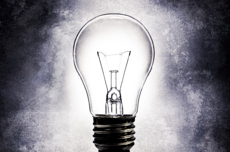 electric bulb: Electric light bulb on light textured background