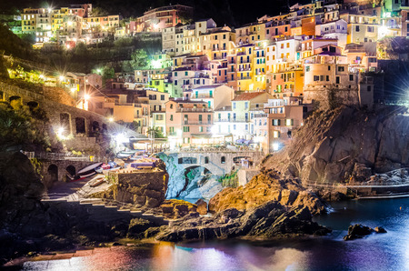 Scenic night view of colorful village Manarola in Cinque Terre, Italy photo