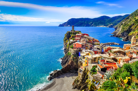 Scenic view of colorful village Vernazza and ocean coast in Cinque Terre, Italy photo