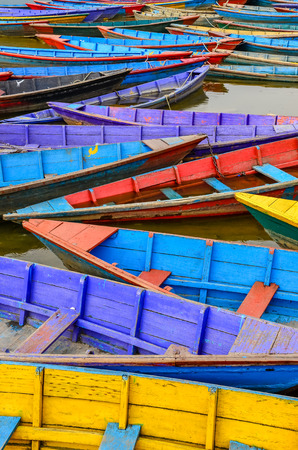 Detail of old colorful sail boats in the lake, Pokhara, Nepal