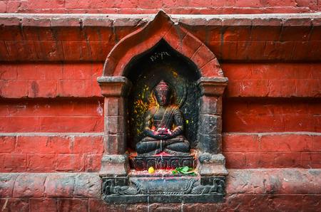 hinduist: Detail of Buddha statue on Swayambhu temple, Kathmandu, Nepal Stock Photo