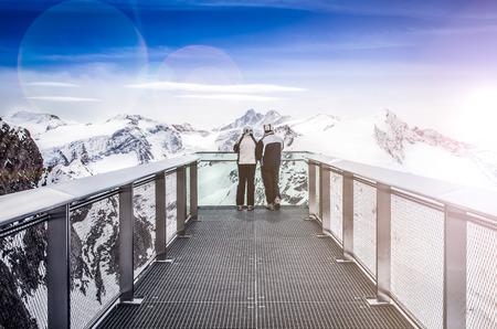 kitzsteinhorn: Two people looking at Alps mountains from viewpoint platform, Kaprun area, Austria