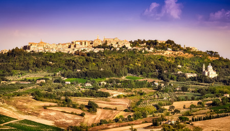 View of Montepulciano town and wine country landscape, Tuscany, Italy photo