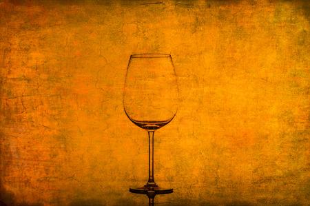 Empty wine glass on nice rusty old vintage texture photo