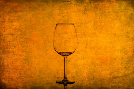 Empty wine glass on nice rusty old vintage texture photo
