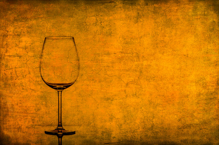 Empty wine glass on nice rusty vintage texture with room for text photo