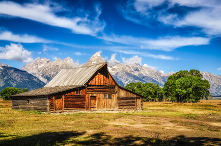 Grand Teton scenic view with abandoned barn on Mormon Row, Wyoming, USA