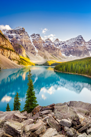 banff: Landscape view of Moraine lake and mountain range at sunset in Canadian Rocky Mountains