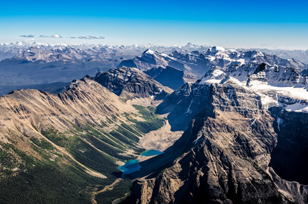 Mountain range view from Mt Temple, Banff NP, Rocky Mountains, Alberta, Canada photo