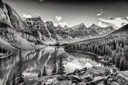 rocky mountain national park: Monochrome filtered grainy landscape view of Moraine lake and mountain range in Canadian Rocky Mountains