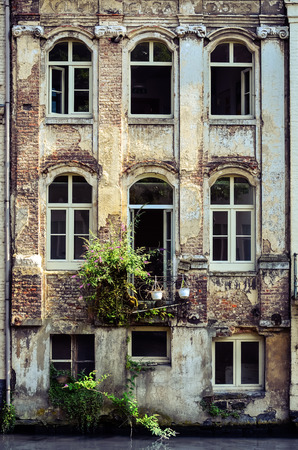 gent: Old weathered wall with vintage windows, Gent, Belgium Stock Photo