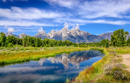 Landscape view of Grand Teton mountains  with water reflection Wyoming USA