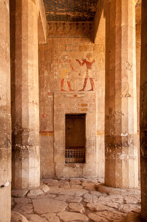 Hieroglyphs on stone walls and stone pillars in Queen Hatshepsut temple Egypt