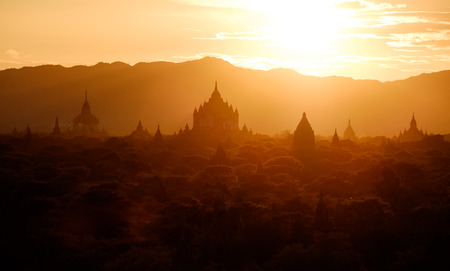 Beautiful sunset landscape view with ancient temples at Bagan, Myanmar Stock Photo