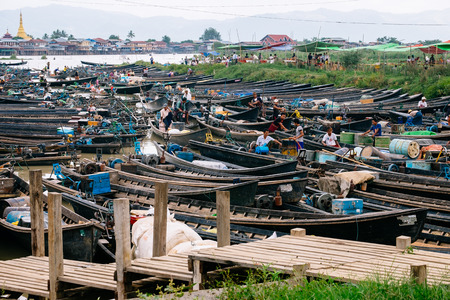 floating market: Nampan Inle Lake, Myanmar - 4 July, 2015: Boats, traders and local people entering and leaving floating market