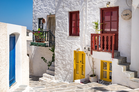 Scenic view of colorful street in traditional Greek cycladic village Plaka, Milos island, Greece Stock Photo