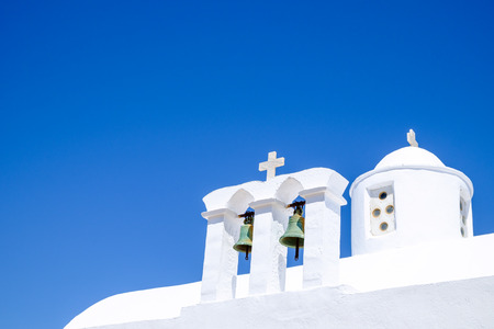 cycladic: Detail view of bells and roof of traditional Greek cycladic church, Plaka village, Greece Stock Photo