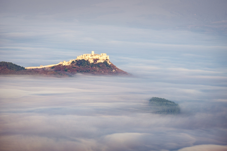 above the clouds: Scenic view of Spis castle at sunrise in dreamy style above clouds, Spisske Podhradie, Slovakia Editorial