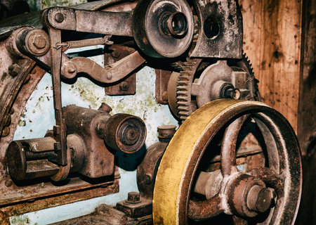 old factory: Detail of old vintage industrial production machine wheels