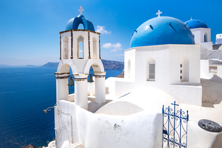 Scenic view of traditional cycladic blue white and blue domes in Oia village, Santorini island, Greece