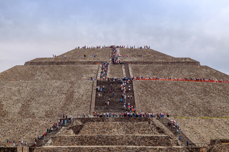 crowds of people: TEOTIHUACAN, MEXICO - 28 DECEMBER 2015: Crowds of people climb on Pyramid of the Sun, Teotihuacan, Mexico Editorial