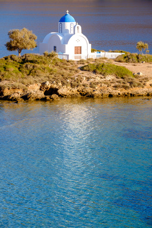 anna: Landscape view of white orthodox church at mediterranean beach, Amorgos island, Cyclades, Greece Stock Photo
