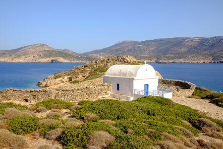 church bell: Landscape view of white chapel at beautiful ocean coastline, Amorgos island, Cyclades, Greece