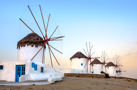 Scenic view of traditional greek windmills on Mykonos island at sunrise, Cyclades, Greece